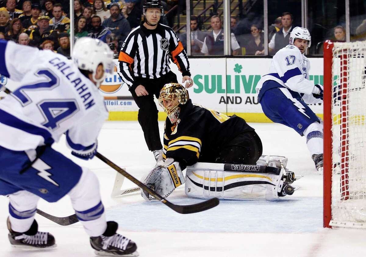 Tampa Bay Lightning's Ryan Callahan (24) scores against Boston Bruins' Tuukka Rask (40) on an assist from teammate Alex Killorn (17) during the first period of an NHL hockey game in Boston, Sunday, Feb. 28, 2016. (AP Photo/Michael Dwyer) ORG XMIT: MAMD101