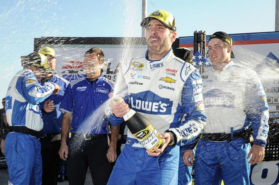 Jimmie Johnson celebrates after winnning a NASCAR Sprint Cup Series auto race at Atlanta Motor Speedway, Sunday, Feb. 28, 2016, in Hampton, Ga. (AP Photo/John Amis) ORG XMIT: GAJA118 Photo: John Amis / FR69715 AP
