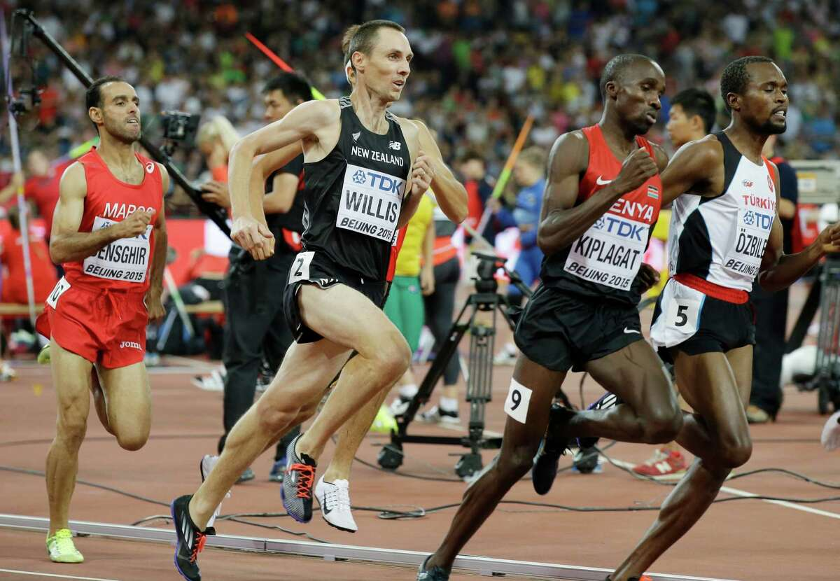 FILE - In this Aug. 28, 2015, file photo, New Zealand's Nick Willis runs in his men's 1,500-meter semifinal at the World Athletics Championships at the Bird's Nest stadium in Beijing. Willis, who won the silver medal in the 1,500 meters at the 2008 Beijing Games, and his wife Sierra Willis, who is on his coaching staff, says, ?