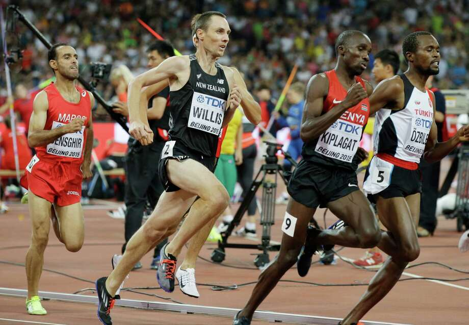 """FILE - In this Aug. 28, 2015, file photo, New Zealand's Nick Willis runs in his men's 1,500-meter semifinal at the World Athletics Championships at the Bird's Nest stadium in Beijing. Willis, who won the silver medal in the 1,500 meters at the 2008 Beijing Games, and his wife Sierra Willis, who is on his coaching staff, says, """"We've had a lot of conversations about the Zika virus. ... We have a 2½-year-old son, my wife and I, and we'd like to add to that family and grow it."""" (AP Photo/Kin Cheung, File) ORG XMIT: NY113 Photo: Kin Cheung / AP"""