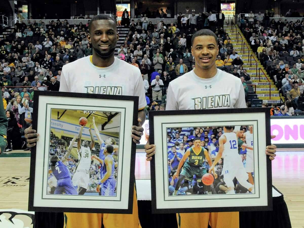Siena seniors Imoh Silas ,left, and Ryan Oliver ,right, are honored before playing Quinnipiac in a Metro Atlantic Athletic Conference NCAA college basketball game in Albany, N.Y., Sunday, Feb. 28, 2016. (Hans Pennink / Special to the Times Union) ORG XMIT: HP101