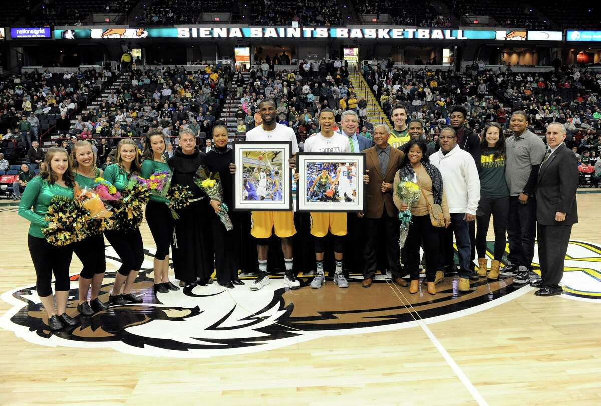 Siena seniors who were honored in a ceremony pose for a photograph with family members and members of Siena college before playing Quinnipiac in Metro Atlantic Athletic Conference NCAA college basketball game in Albany, N.Y., Sunday, Feb. 28, 2016. (Hans Pennink / Special to the Times Union) ORG XMIT: HP102