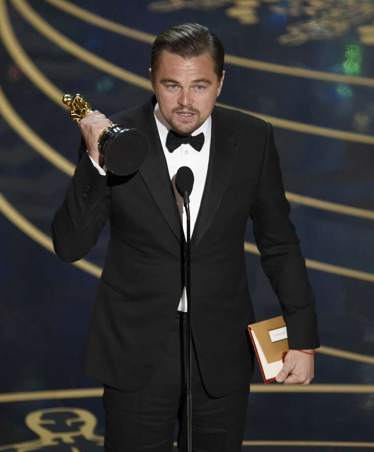 "Leonardo DiCaprio accepts the award for best actor in a leading role for ""The Revenant"" at the Oscars on Sunday, Feb. 28, 2016, at the Dolby Theatre in Los Angeles. (Photo by Chris Pizzello/Invision/AP) Photo: Chris Pizzello, Associated Press"