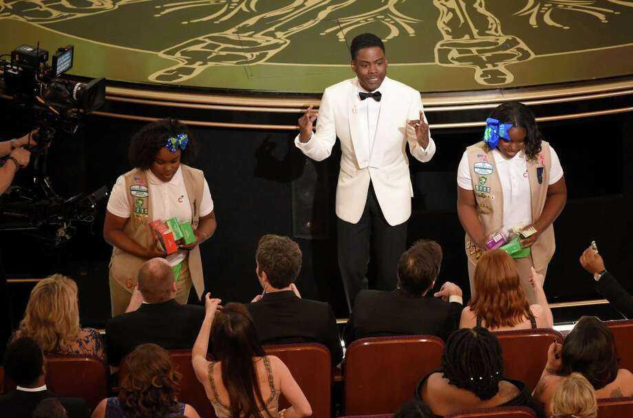 Host Chris Rock sells Girl Scout cookies in the audience at the Oscars on Sunday, Feb. 28, 2016, at the Dolby Theatre in Los Angeles. (Photo by Chris Pizzello/Invision/AP) ORG XMIT: CACJ454 Photo: Chris Pizzello / Invision