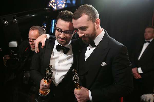Jimmy Napes, left, and Sam Smith as seen from backstage accepting the award for best original song for ìWritingís On The Wallî at the Oscars on Sunday, Feb. 28, 2016, at the Dolby Theatre in Los Angeles. (Photo by Matt Sayles/Invision/AP)