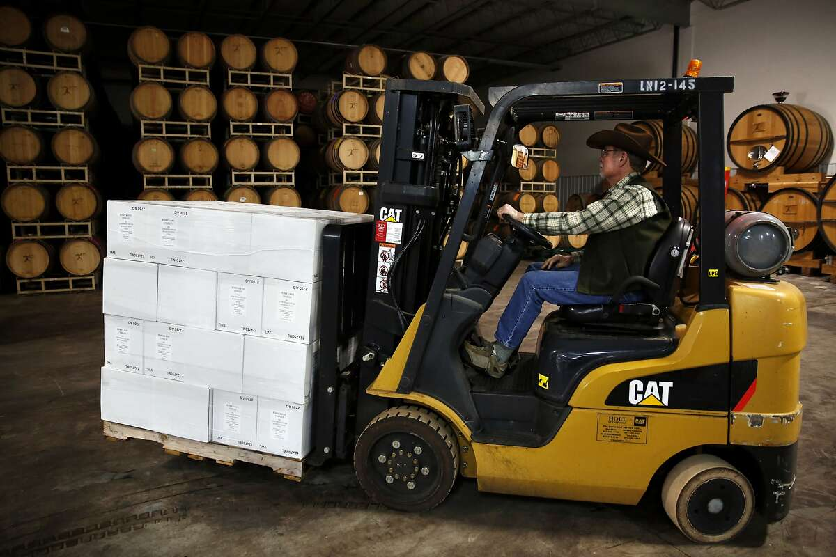 Joel Peterson uses a forklift to move some boxes in a warehouse in Sonoma, California, on Sunday, Feb. 28, 2016.