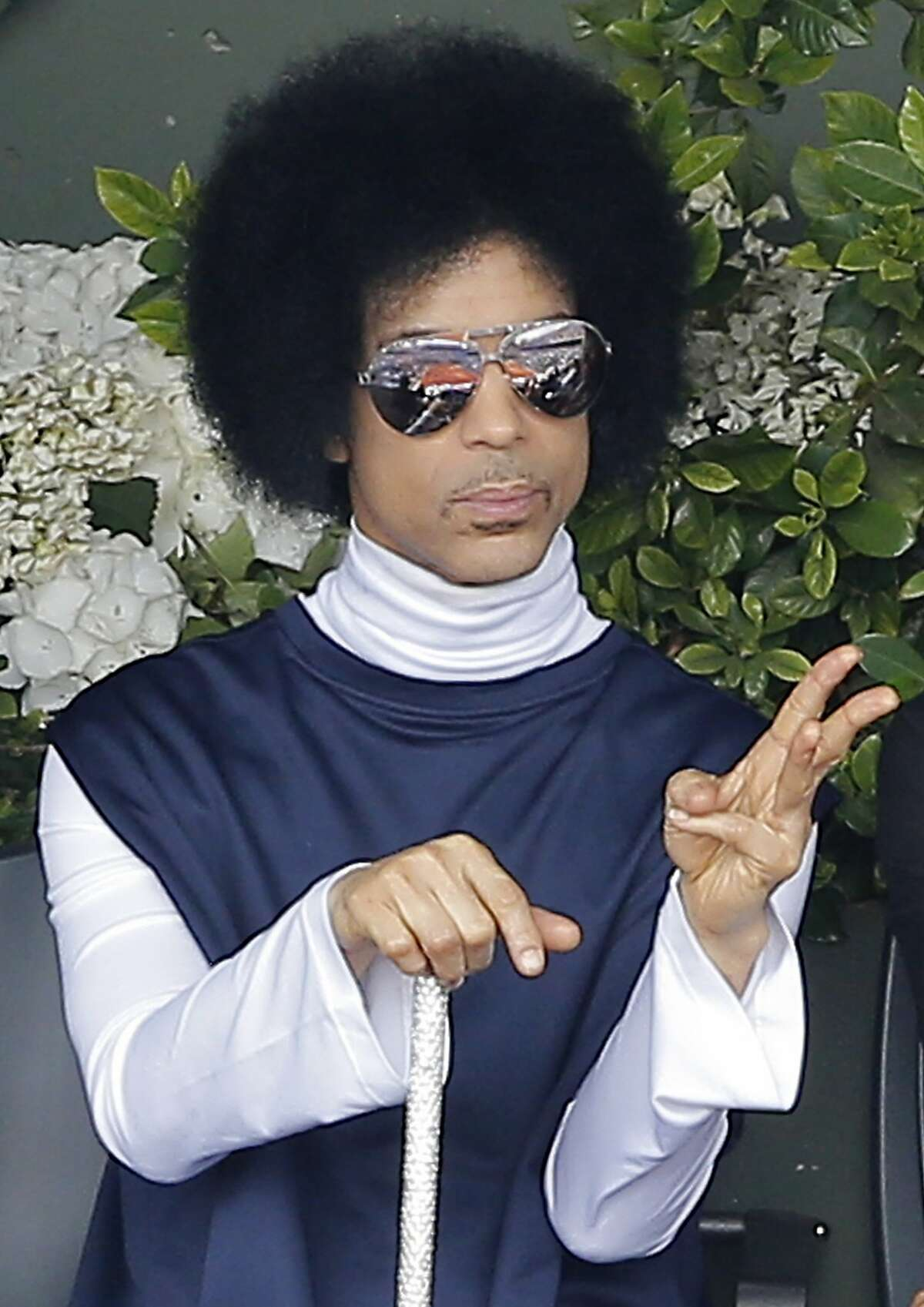 FILE - In this Monday, June 2, 2014, file photo, U.S. pop singer Prince watches the fourth round match of the French Open tennis tournament between Spain's Rafael Nadal and Serbia's Dusan Lajovic at the Roland Garros stadium, in Paris.
