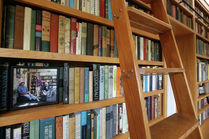 Camille Rosengren, who owned Rosengren's Books downtown, had wooden shelves, seen Feb. 22, 2016, built into the hallway of her home -- complete with a climb-up ladder-- 10 years ago to hold her and her husband's books.