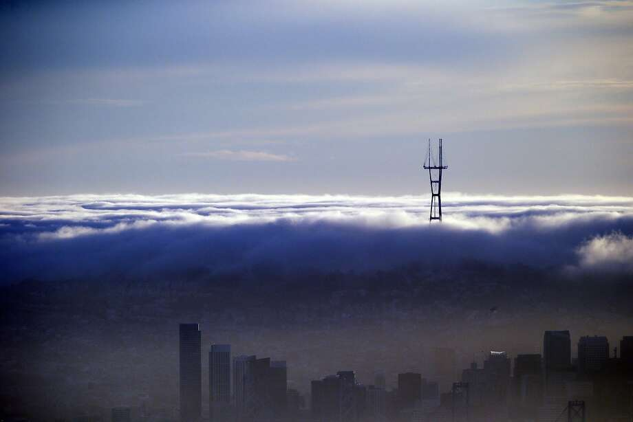 The Sutro Tower, top right, is seen over a blanket of fog and the San Francisco skyline in a view from the Berkeley Hills Sunday, Feb. 28, 2016, in Berkeley, Calif. (AP Photo/Marcio Jose Sanchez) Photo: Marcio Jose Sanchez, Associated Press