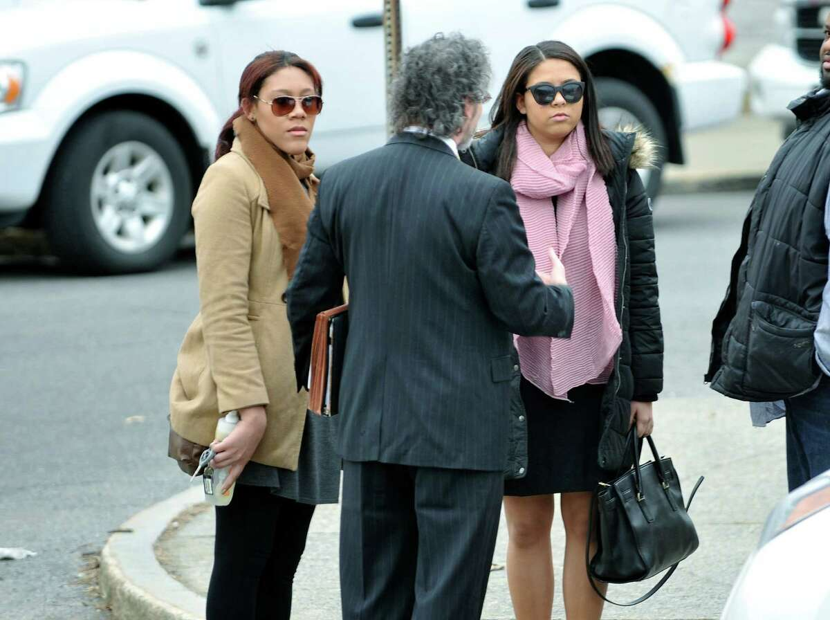 Ariel Agudio, left, and Alexis Briggs, right, make their way into Albany City Criminal Court on Monday, Feb. 29, 2016, for their arraignments on charges related to an assault that took place on a CDTA bus on the University at Albany campus. (Paul Buckowski / Times Union)