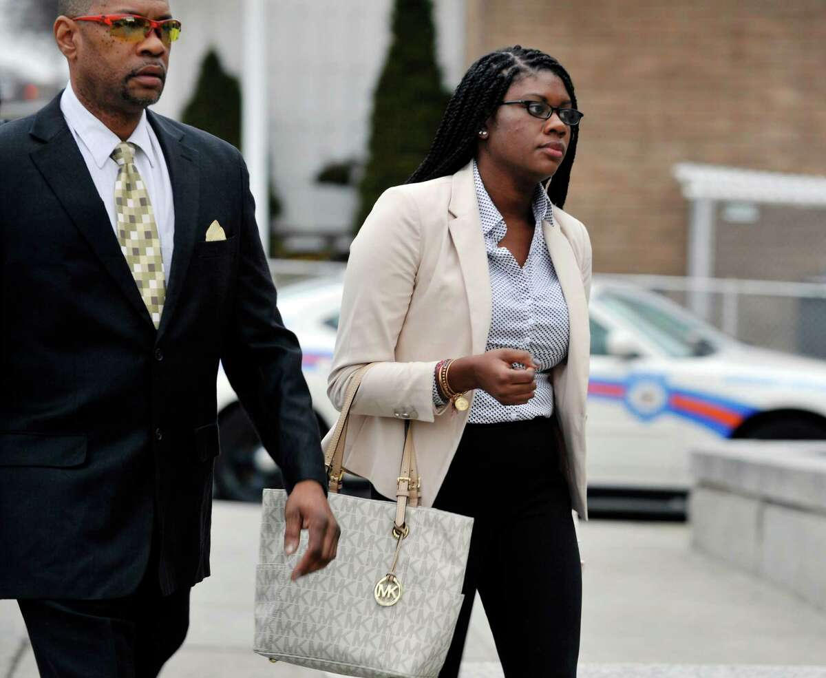 Asha Burwell makers her way into Albany City Criminal Court on Monday, Feb. 29, 2016, for her arraignment for charges related to an assault that took place on a CDTA bus on the University at Albany campus. (Paul Buckowski / Times Union)