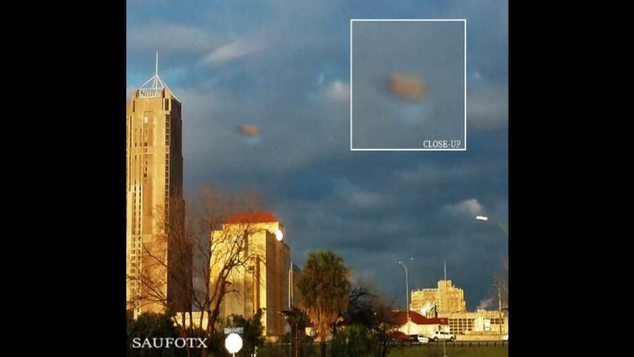 """UFO watcher SAUFOTX uploaded the video claims that video footage captured last week shows a """"huge UFO using camouflage technology"""" over downtown San Antonio. Photo: Screenshot Via YouTube"""