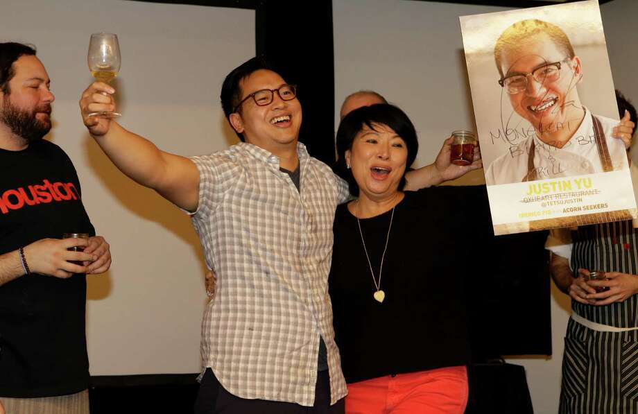 Chef Justin Yu of Oxheart celebrates winning at the Cochon555 event at the JW Marriott Houston Downtown, 806 Main St., Sunday, Feb. 28, 2016, in Houston. Photo: Melissa Phillip, Houston Chronicle / © 2016 Houston Chronicle