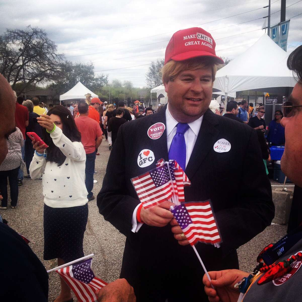 A Donald Trump impersonator made a cameo and quickly became a selfie pit stop for many festival attendees. Note that his cap reads