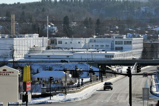 A view of the former Beech Nut plant complex, large white buildings, seen here on Tuesday, Jan. 13, 2015, in Canajoharie, N.Y.  Demolition work has begun at the plant.  (Paul Buckowski / Times Union)