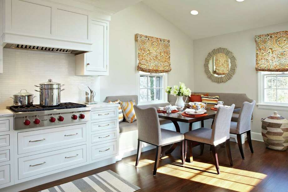 Deane Inc., in Stamford and New Canaan, has been featuring integrated banquettes, such as this one with a free-standing table, for new kitchens. Photo: Contributed Photo / Contributed Photo / Connecticut Post Contributed