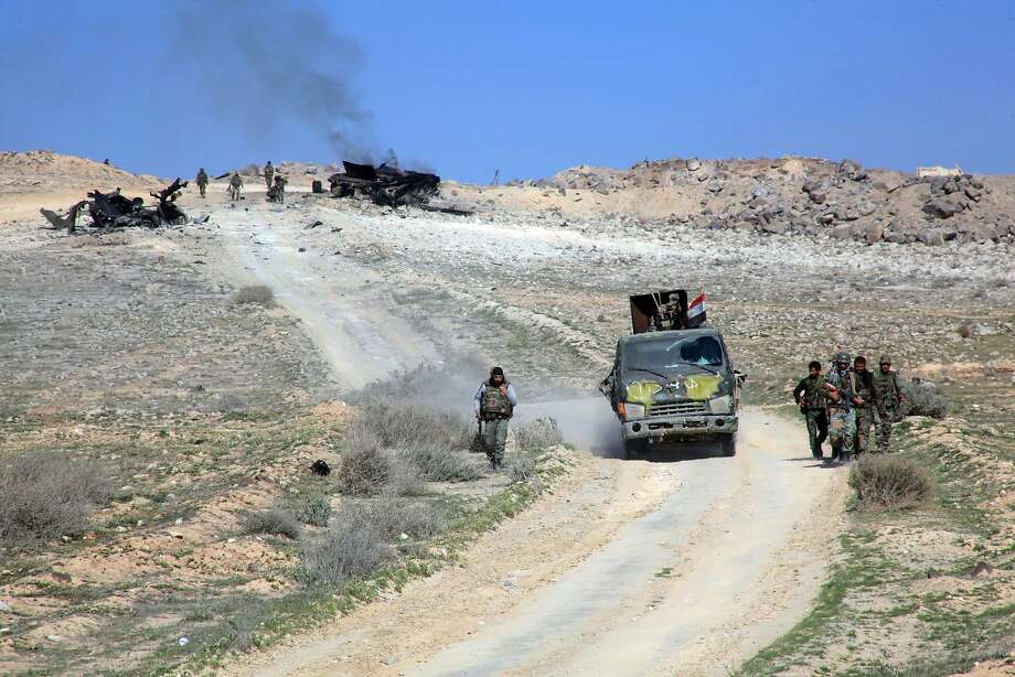Syrian forces advance on a road recaptured from the Islamic State near the town of Khanasser. Photo: Georges Ourfalian, AFP / Getty Images