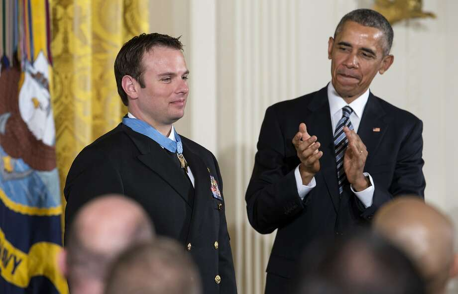 President Obama applauds after presenting the Medal of Honor to Edward Byers. Photo: J. Scott Applewhite, Associated Press