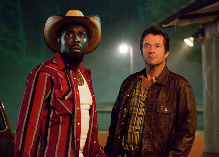 """Michael Kenneth Williams (left) and James Purefoy banter constantly in """"Hap and Leonard's"""" well-written script. The pair set out to find  a gang's long-missing loot, but the larger story is about character, setting and dialogue in a hardscrabble East Texas setting. Photo: Hilary Gayle/SundanceTV / Hilary Gayle / SundanceTV / © 2015 SundanceTV LLC. All Rights Reserved."""