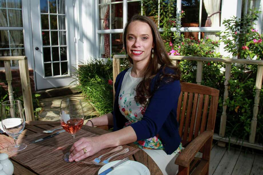 Brittany Brown on the botanical deck of the Manor House with her wine of choice. Photo: Gary Fountain, For The Chronicle / Copyright 2016 Gary Fountain