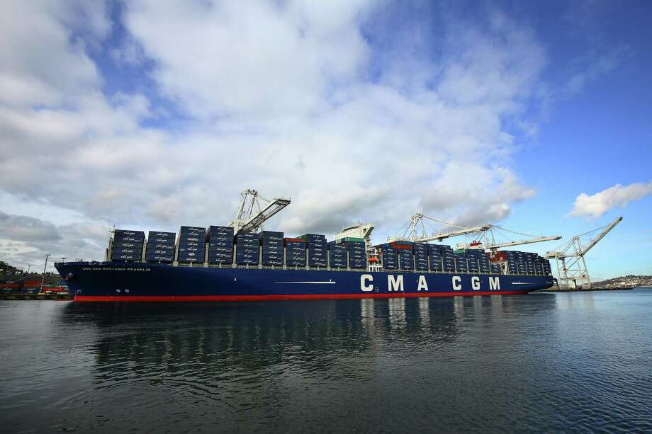The CMA CGM Benjamin Franklin, the largest container ship ever to call on a U.S. port, arrived to Seattle's Terminal 18 on Monday, Feb. 29, 2016.  The vessel is 1,300 feet long, 177 feet wide, 197 feet high and can carry up to 18,000 containers. It is scheduled to leave Tuesday morning for China. Photo: GENNA MARTIN, SEATTLEPI.COM / SEATTLEPI.COM
