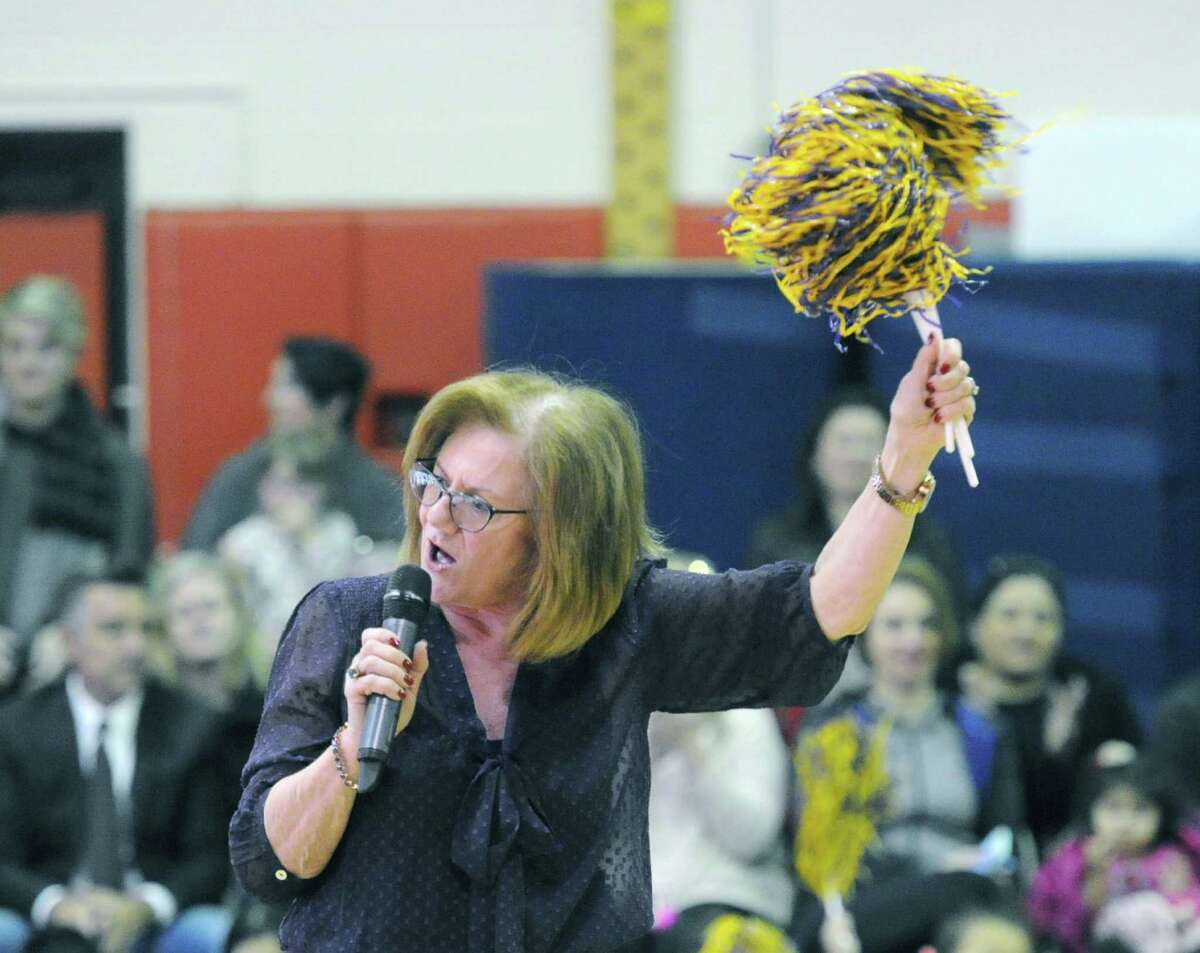 New Lebanon School Principal Barbara Riccio uses a pompom to cheer.