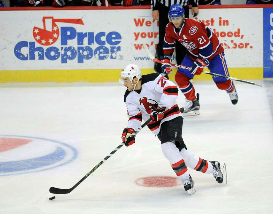 Albany Devils' Corey Tropp (25) moves the puck against St. John's IceCaps' during the second period of an AHL hockey game in Albany, N.Y., Wed., Feb. 24, 2016.  (Hans Pennink / Special to the Times Union) ORG XMIT: HP107 Photo: Hans Pennink / Hans Pennink