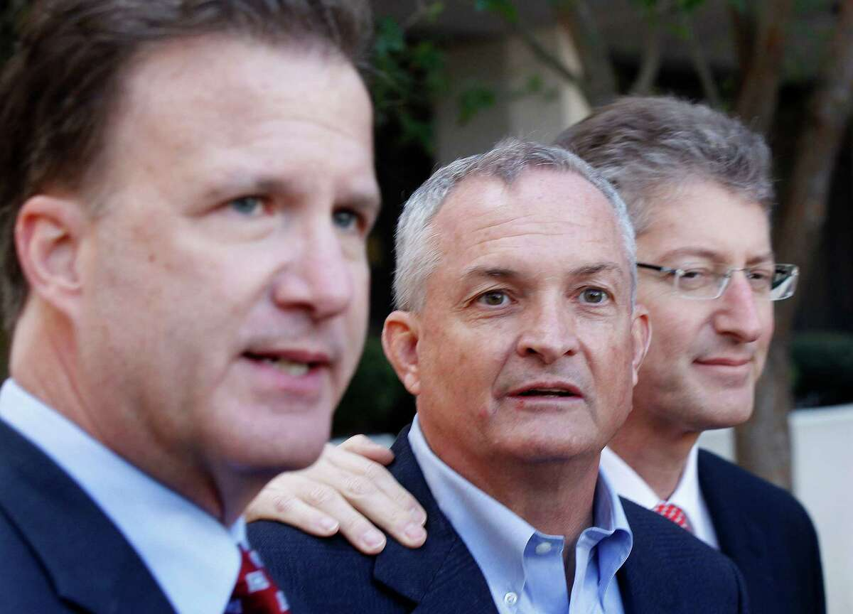 Robert Kaluza, a BP well site leader from the Deepwater Horizon oil rig explosion, talks with his attorneys Shaun Clarke, left, and David Gerger, right, as they enter Federal Court before he is arraigned on in New Orleans, Wednesday, Nov. 28, 2012. (AP Photo/Gerald Herbert)