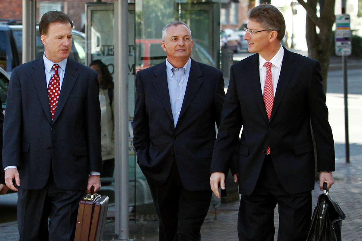 Robert Kaluza, center, arrives in 2012 with his attorneys Shaun Clarke, left, and David Gerger at federal court in New Orleans.