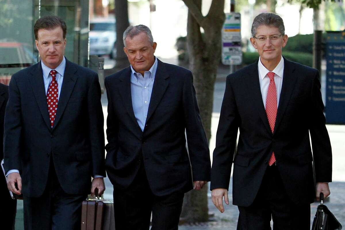 Robert Kaluza, a well site manager for BP during the 2010 explosion on board the Deepwater Horizon oil rig, center, arrives at federal court with his attorneys Shaun Clarke, left, and David Gerger, right, on in New Orleans, Louisiana, U.S., on Wednesday, Nov. 28, 2012..( Photographer: Derick E. Hingle/Bloomberg)