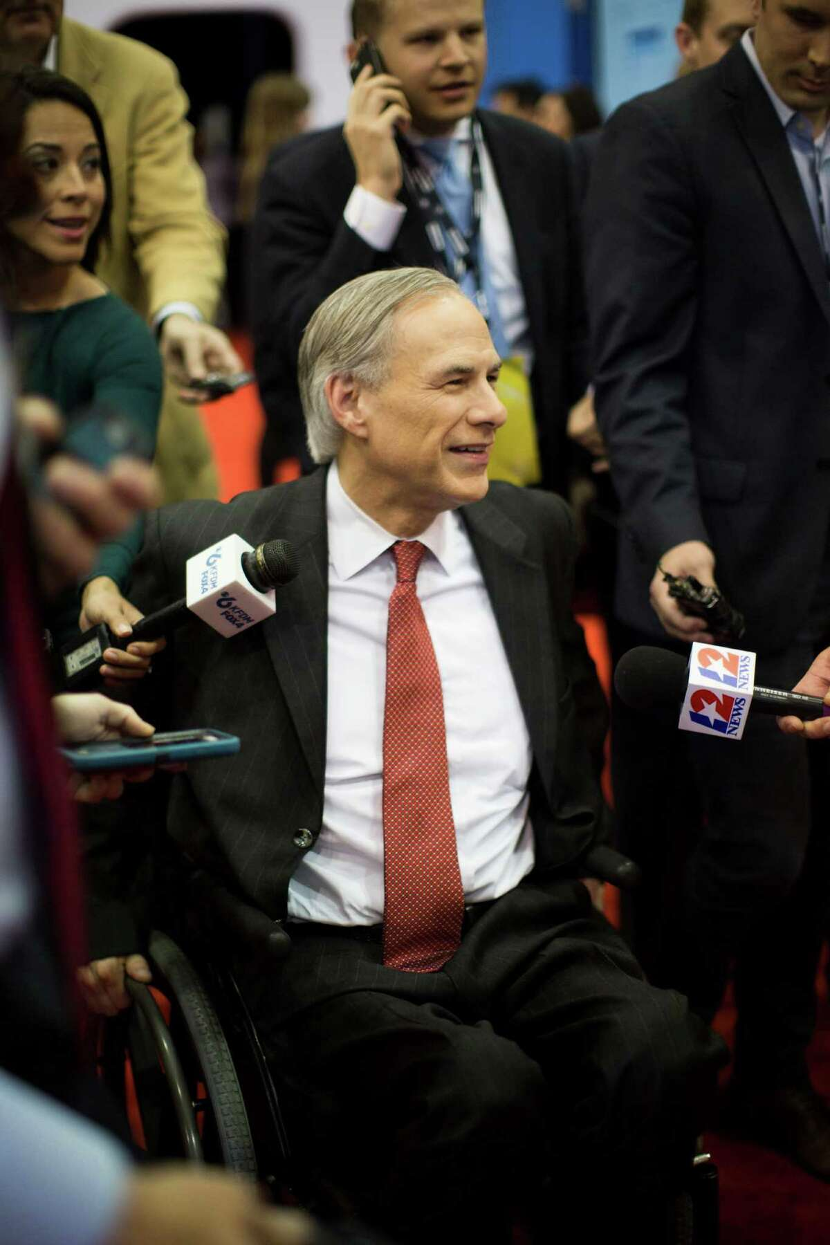 Texas Governor Greg Abbott meets with the media at the Spin Room hours before the Republican presidential primary debate at the University of Houston, Thursday, Feb. 25, 2016, in Houston.