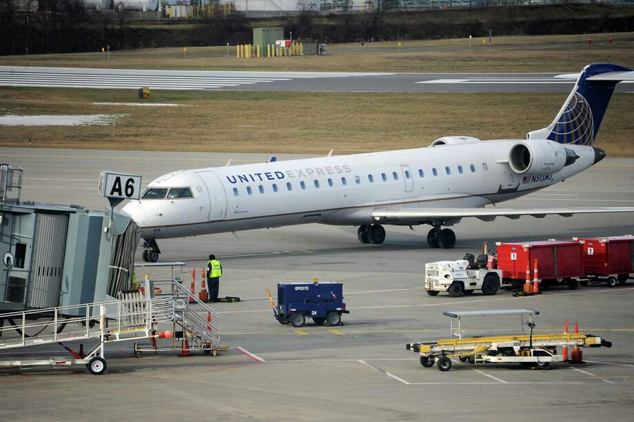A United regional jet taxis to a gate at the Albany International Airport on Monday, Jan. 11, 2016 in Albany, N.Y.  (Lori Van Buren / Times Union) Photo: Lori Van Buren / 10034949A