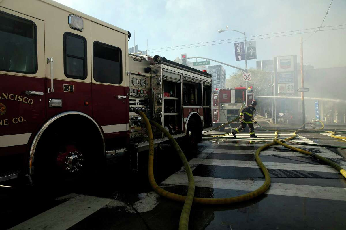 Firefighters work to put out out a blaze at a Chevron gas station in San Francisco, California, on Monday, Feb. 29, 2016.