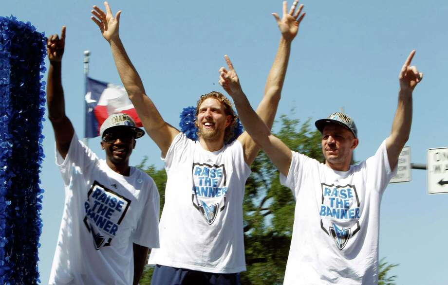 Dallas Mavericks players Dirk Nowitzki, center, of Germany,, Jason Kidd, right, and Jason Terry wave to fans during the team's victory parade in downtown Dallas, Thursday, June 16, 2011. The Mavericks beat the Miami Heat to win the NBA championship. (AP Photo/LM Otero) Photo: LM Otero, Associated Press / AP
