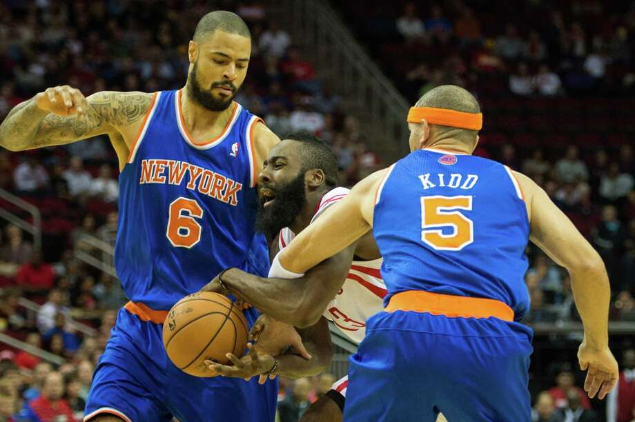 Houston Rockets shooting guard James Harden (13) drives between New York Knicks point guard Jason Kidd (5) and center Tyson Chandler (6) during the first half of an NBA basketball game at Toyota Center on Friday, Nov. 23, 2012, in Houston. Photo: Smiley N. Pool, Houston Chronicle / © 2012  Houston Chronicle