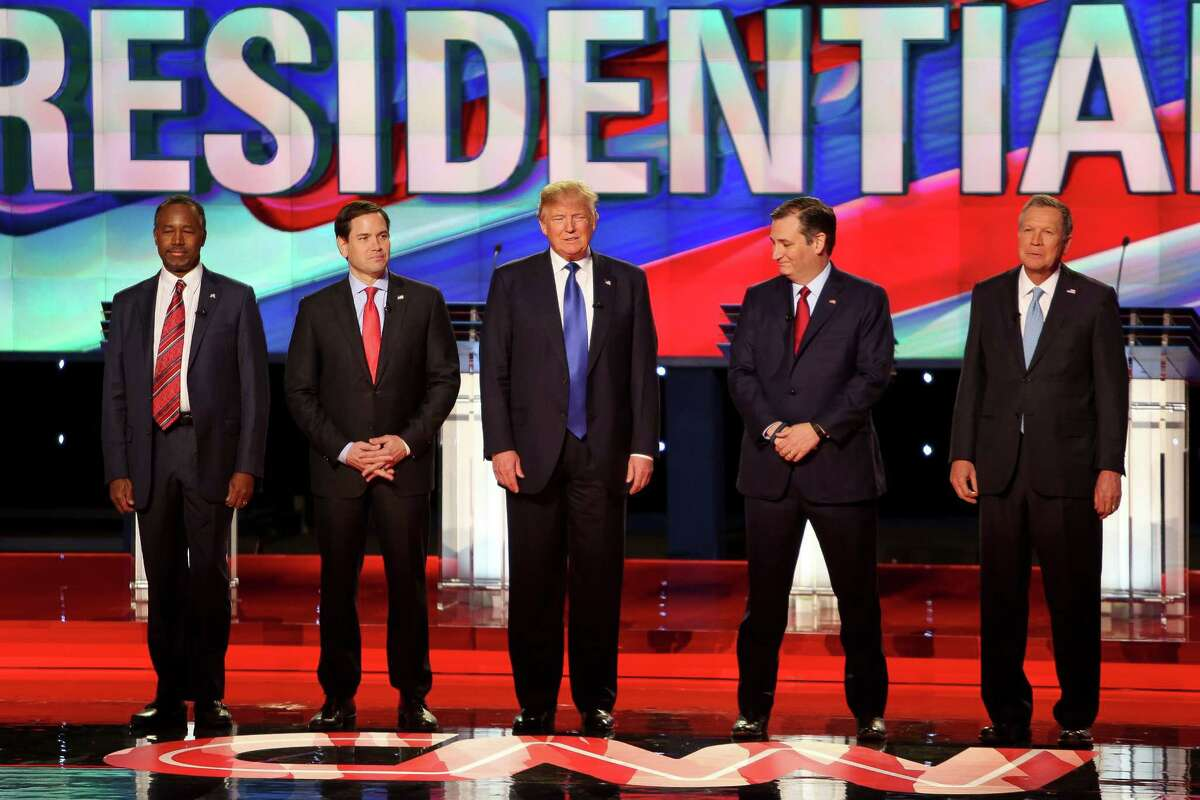 Presidential candidates Ben Carson, Marco Rubio, Donald Trump, Ted Cruz and John Kasich stand before the national anthem during the Republican Presidential Primary Debate at the University of Houston Thursday, Feb. 25, 2016.