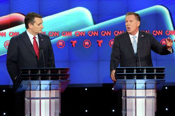 Ted Cruz, left, listens as John Kasich answers a question during the Republican Presidential Primary Debate at the University of Houston Thursday, Feb. 25, 2016.