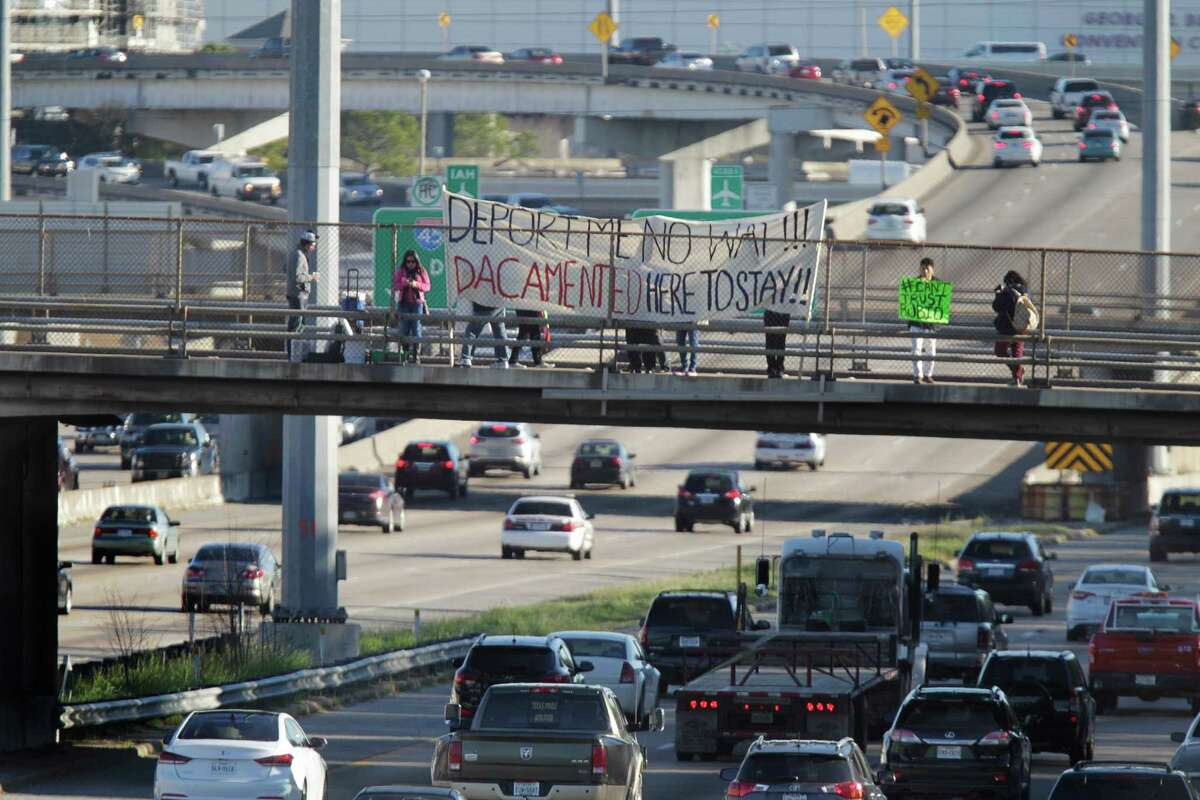 Leaders from United We Dream Action deliver the perspective of immigrant youth to Houston commuters with banners and signs Thursday, Feb. 25, 2016, in Houston.