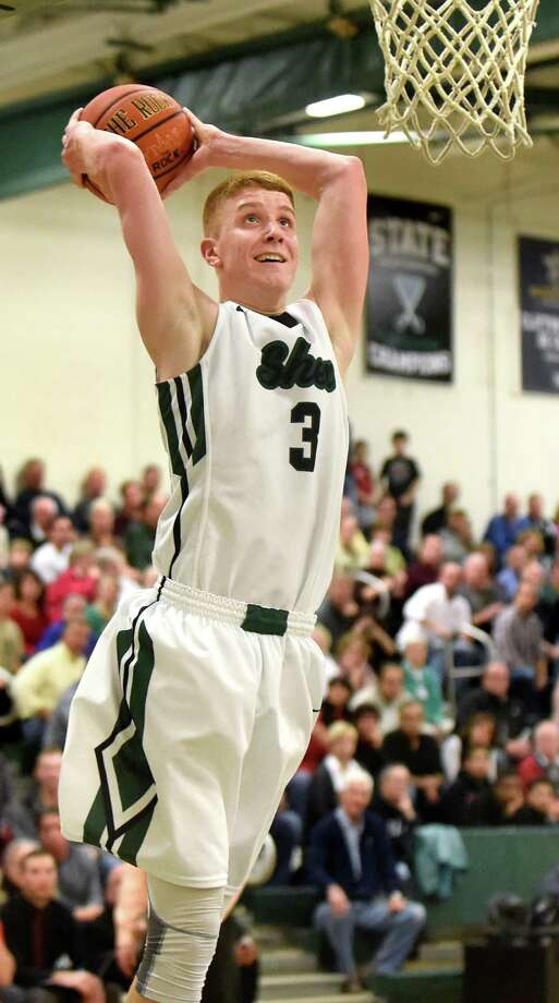 Shen's Kevin Huerter dunks the ball during their basketball game against Guilderland on Friday, Dec. 11, 2015, at Shenendehowa High in Clifton Park, N.Y.  (Cindy Schultz / Times Union) Photo: Cindy Schultz / 10034609A