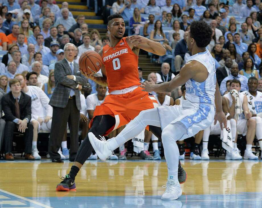 CHAPEL HILL, NC - FEBRUARY 29:  Michael Gbinije #0 of the Syracuse Orange is called for a foul as he drives agianst Joel Berry II #2 of the North Carolina Tar Heels during their game at the Dean Smith Center on February 29, 2016 in Chapel Hill, North Carolina.  (Photo by Grant Halverson/Getty Images) ORG XMIT: 587451687 Photo: Grant Halverson / 2016 Getty Images