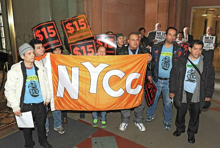 A group of low-wage workers from New York City join faith and community leaders for a vigil and rally in support of a living wage and an end to wage theft at the Capitol on Monday, Feb. 29, 2016 in Albany N.Y. (Lori Van Buren / Times Union) Photo: Lori Van Buren / 10035621A