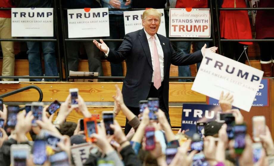 Republican presidential candidate Donald Trump gestures during a rally at Radford University in Radford, Va., Monday, Feb. 29, 2016. (AP Photo/Steve Helber) ORG XMIT: VASH118 Photo: Steve Helber / AP