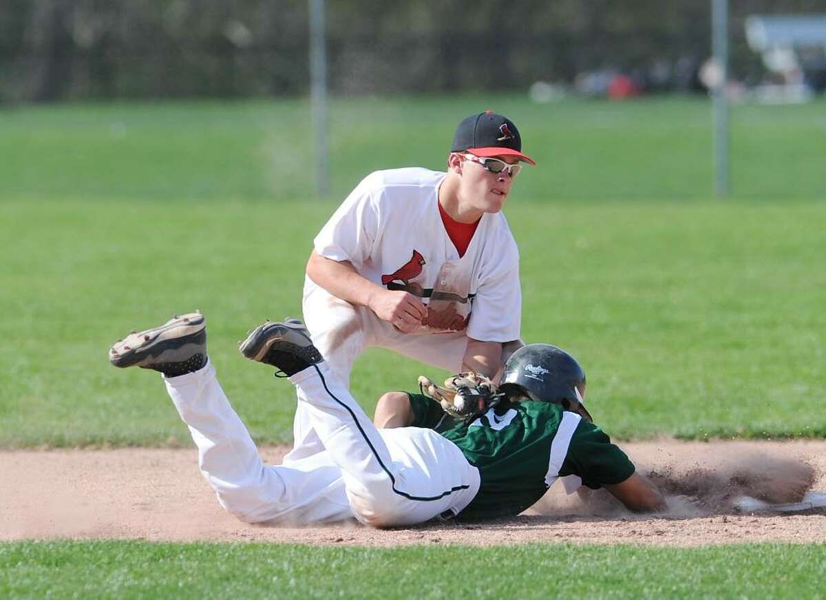 GHS shortstop, Michael Dunster, # 24, puts the tag on Chris Kassimis, # 9, of NHS during an unsuccessful pick-off during Greenwich High School vs. Norwalk High School game in which Greenwich High School won 4-1, April 7, 2010.