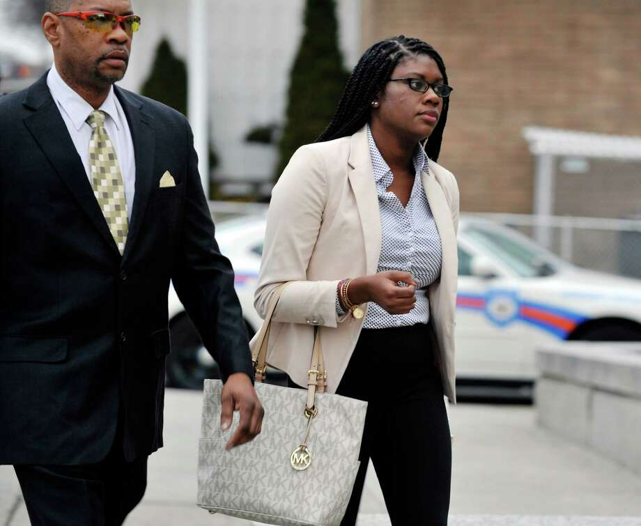 Asha Burwell makers her way into Albany City Criminal Court on Monday, Feb. 29, 2016, for her arraignment for charges related to an assault that took place on a CDTA bus on the University at Albany campus.   (Paul Buckowski / Times Union) Photo: PAUL BUCKOWSKI / 10035595A