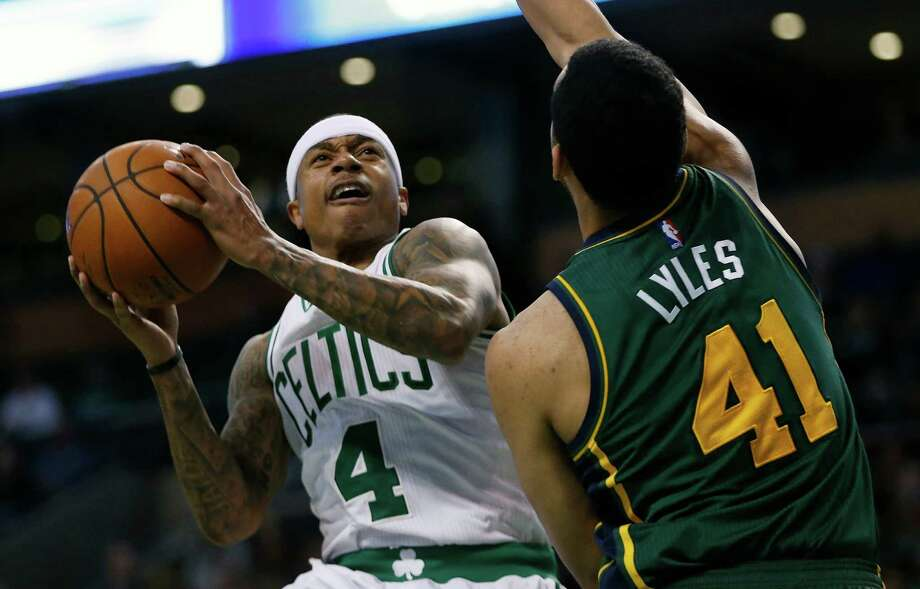 Boston Celtics' Isaiah Thomas (4) shoots against Utah Jazz's Trey Lyles (41) during the third quarter of an NBA basketball game in Boston, Monday, Feb. 29, 2016. The Celtics won 100-95. (AP Photo/Michael Dwyer) ORG XMIT: MAMD104 Photo: Michael Dwyer / Copyright 2016 The Associated Press. All rights reserved. This m