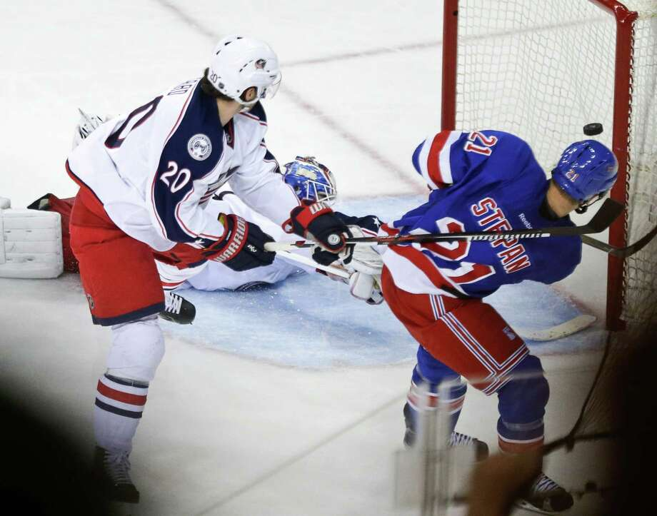 New York Rangers' Derek Stepan (21) shoots the puck past Columbus Blue Jackets goalie Joonas Korpisalo to score the game winning goal during the third period of an NHL hockey game Monday, Feb. 29, 2016, in New York. The Rangers won 2-1.(AP Photo/Frank Franklin II) ORG XMIT: MSG110 Photo: Frank Franklin II / AP