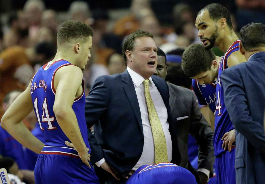 Kansas head coach Bill Self, center, talks to his players during the first half of an NCAA college basketball game against Texas, Monday, Feb. 29, 2016, in Austin, Texas. (AP Photo/Eric Gay) Photo: Eric Gay, Associated Press / AP