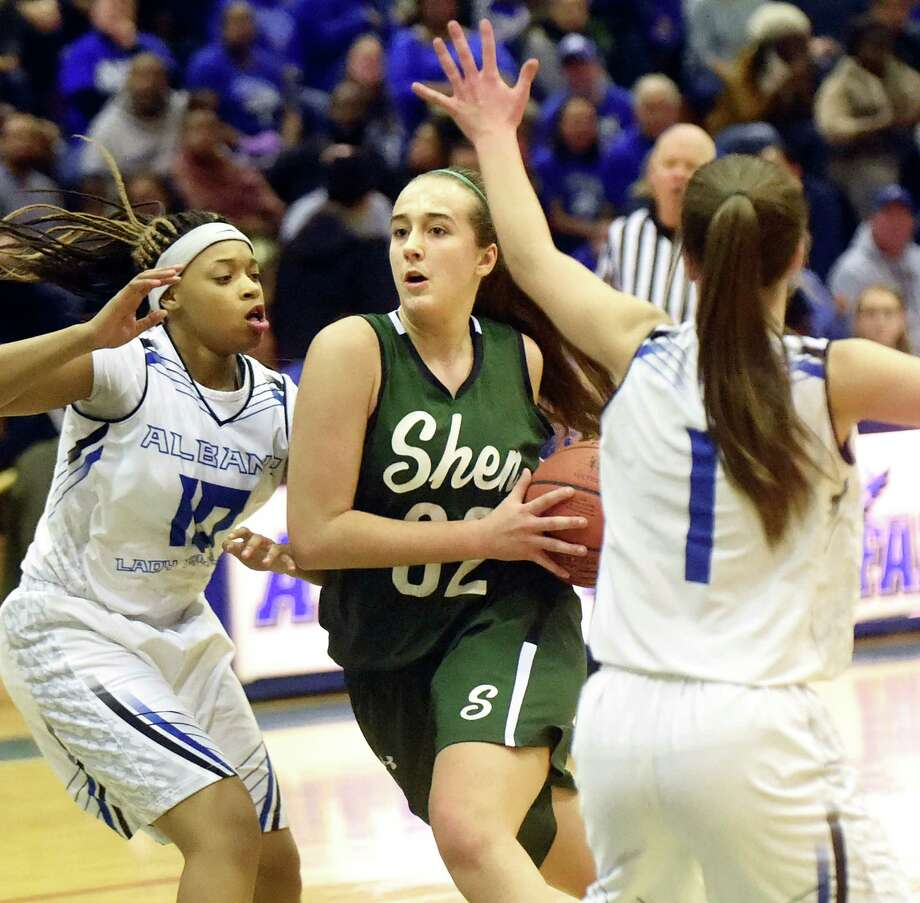 Shenendehowa's Carly Boland, center, drives through the defense of Albany's Junasia Lanier, left, and Bridget Whelan during their basketball game on Friday, Jan. 22, 2016, at Albany High in Albany, N.Y. (Cindy Schultz / Times Union) Photo: Cindy Schultz / 10035097A