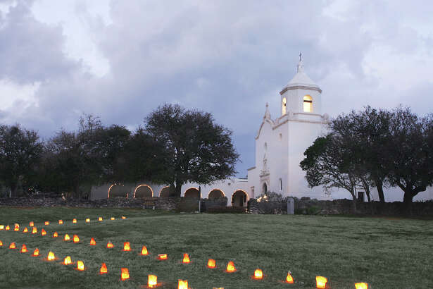"""Mission buildings and grounds at Goliad State Park sparkle with thousands of lights and luminaries during the """"History of Lights"""" that lasts through the end of the year."""