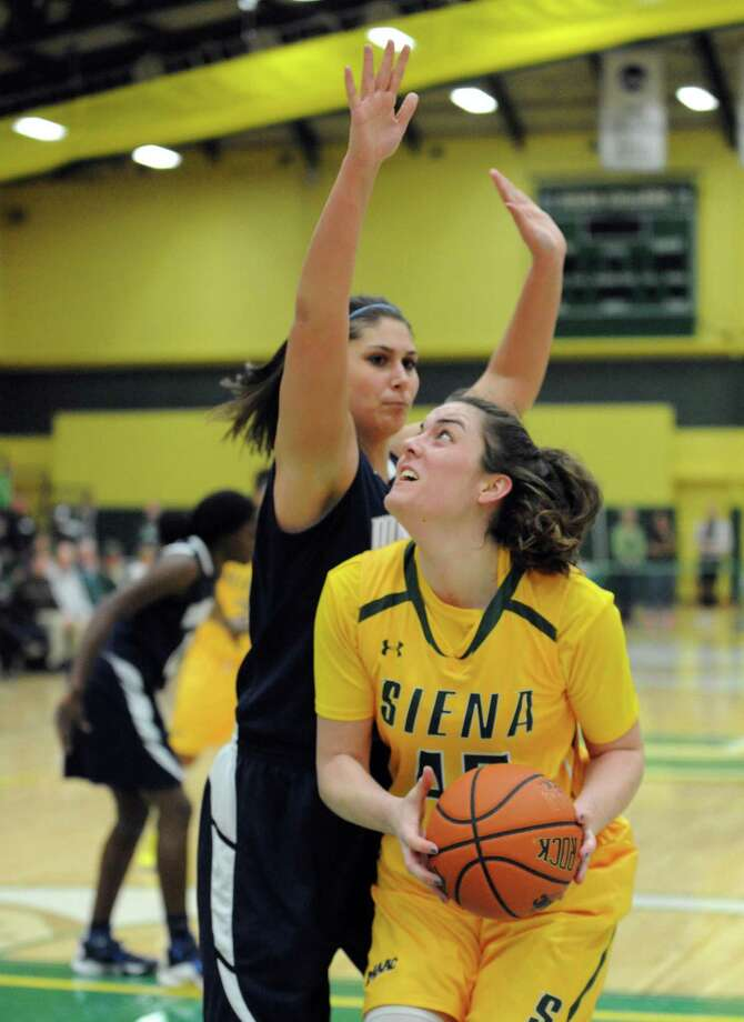 Siena's Meghan Donohue drives to the basket during their women's college basketball game against Monmouth at the Alumni Recreation Center on Friday Jan. 15, 2016 in Loudonville, N.Y. (Michael P. Farrell/Times Union) Photo: Michael P. Farrell / 10034982A